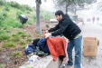 Izzy Matos, CityHeARTist, covers a homeless person with a blanket donated to CityHeART for the Valentine's Day, 2016 blanket drive.