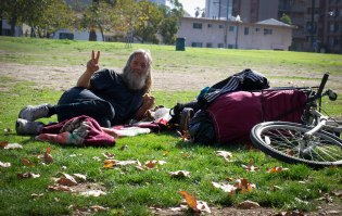 "THE COLD WAR: Steven James Peterson eats a peanut butter and jelly sandwich in Cesar E. Chavez Park near the Los Angeles River in downtown Long Beach Jan. 24, 2015. He said, ""It was because of the Cold War."" Steven was friendly and eager to share his story."