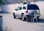 ENVOY: MORE THAN JUST A CAR An Envoy is parked on W Sixth Street near the I-710 on the bike path that leads to the Los Angeles River Jan. 24, 2015. It appears that someone is living out of the SUV.