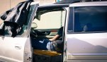 OPEN DOORS: A man sleeps with the driver's side door open, maybe to keep from getting too hot Jan. 24, 2015. The man appears to live out of the Envoy, which is parked on W Sixth Street near the Los Angeles River. Pill bottles full of pills and one full of what look like joints lay on the windshield, on the dashboard and on the roof of the vehicle.